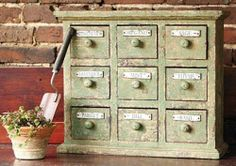 "Braeside Aged Herbal Apothecary Cabinet, 18""Hx22""Wx7""D, AGED GREEN by Home Decorators Collection. $159.00. 18""H x 22""W x 7""D.. A handsome storage piece, the Braeside Aged Herbal Apothecary Cabinet has nine drawers that will help you store toiletries or small accessories throughout your home. Made of wood with a paint finish, this cabinet will complement any decor style. Apothecary style. Aged finish completes the look. Actual size is 18""Hx22""Wx7""D"