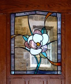 Front door panel based on the theme of the white magnolia flower, 2006. Created with English Antique glasses.