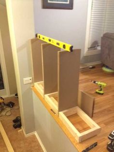 We built a bookcase railing because we didn't want to feel like we lived in … - Home & DIY Bookcase Stairs, Stair Shelves, Stair Storage, Built In Bookcase, Shelving, Basement Stairs, Stairs Kitchen, House Stairs, Shoe Storage