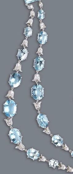 An aquamarine and diamond necklace the swag necklace designed with oval and rectangular-shaped aquamarines, interlaced with round brilliant-cut diamond tulip spacers; estimated total aquamarine weight: 67.65 carats; estimated total diamond weight: 2.40 carats; mounted in eighteen karat white gold; length: 16in.