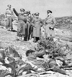Greek communist insurgency, 1946-49: US Army Gen James Van Fleet (first on the right) in charge of US military assistance to the Greek Government, reviews positions in the company of Hellenic Army senior officers. In the foreground, communist KIAs.
