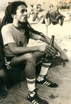 Bob marley drinking after a soccer game. 1977
