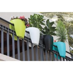 hanging flower pots on the railing.  love this idea