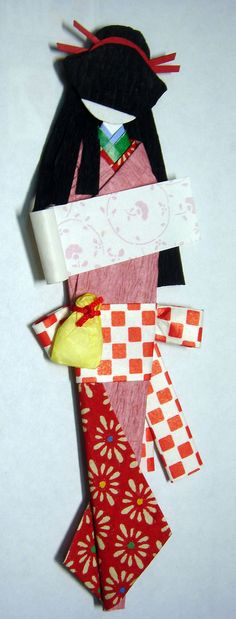 https://flic.kr/p/6DvAcZ   Hand-made Japanese paper doll   Tall origami doll made from yuzen washi, crepe washi, origami washi and origami papers.