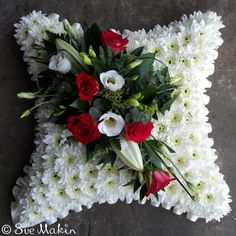 Traditional cushion-shaped tribute, based in white chrysanthemums and dressed with a corsage. You can chose the colour scheme of your corsage below.Size Shown is StandardWe require four working days notice for this piece.Please let us know the time and date of the funeral and the name of the deceased - you can add this in the notes box at checkout. Funeral Arrangements, Flower Arrangements, Traditional Cushions, White Chrysanthemum, Casket Sprays, Funeral Tributes, Sympathy Flowers, Flower Pillow, Funeral Flowers