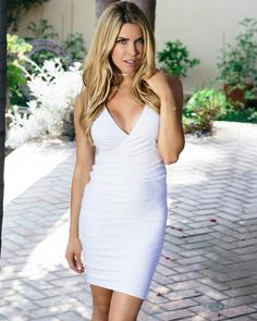 Your LWD. You can never go wrong with white! This mid-length dress can be synched to make it shorter or longer, all on your preference! Luxury jersey.    Dry clean or handwash recommended.