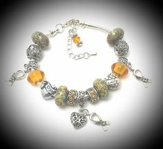 Check out this item in my Etsy shop https://www.etsy.com/listing/277627364/childhood-cancer-awareness-braceletamber