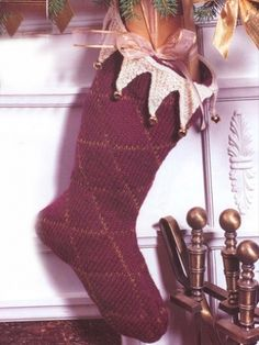 Free Pattern - Classic #knit holiday stocking with subtle diamond pattern and festive zig-zag trim. Perfect to hang by the fire and delight loved ones! #christmas #holidays #winter