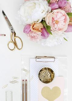 Product styling and photography by Shay Cochrane (www.shaycochrane.com) featuring B is for Bonnie Design (www.bisforbonniedesign.com)  Gold foil notebooks, gold desk accessories, gold confetti, gold scissors, gold tea cup, pink flowers, gold and acrylic Russell and Hazel tape dispenser, pink pencils, gold pencils, Kate Spade desk accessories, work, style, pink, blush, gold paperclips, paper styling, paper, gold foil prints, heart print