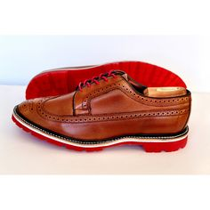 Cognac brown brogue longwing wingtips from Allen Edmonds resoled with white midsoles and red commando soles from Greenwich Vintage. Resole your wingtips, boots and loafers now through www.greenwichvintage.us/shop.