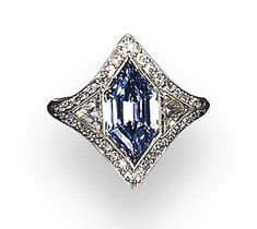 AN EXQUISITE BELLE EPOQUE FANCY TO FANCY DEEP BLUE DIAMOND RING Set with a modified hexagonal step-cut fancy to fancy deep blue diamond weighing approximately 1.80 carats. (by calculation), flanked by triangular-cut diamonds, further accented by circular-cut diamonds and a pierced openwork gallery, mounted in platinum, circa 1920