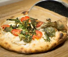 Pizza is one of the simplest dishes you can make as a home baker. After you learn how to make this SUPER tasty sourdough pizza crust you'll never get store-bought dough again. This pizza crust recipe uses type 00 flour, the finest grind of flour capable of being produced by the flour mill. Type 00 flour also yields a crispier pizza crust with a better ability to stand up to heavy working, you know, like being thrown around in the air!This is a dough that yields two large pizzas, or four m...