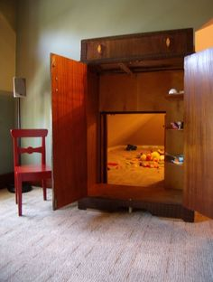 cut out hole in old armoire, fit over door to play room = secret room in the wardrobe...SO COOL. Someday!!