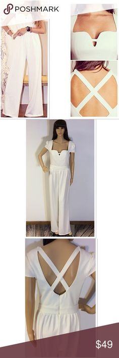 """TIPILLY'S GORGEOUS WHITE JUMPSUIT This stunning White Heather Wide Leg Jumpsuit is the perfect way to stand out in a crowd of cocktail dresses, so steal the spotlight in this classic piece. NWOT. Zips at the back. Very nice material.  Measured lying flat Armpit to armpit 17.5"""" waist 14.5"""" inseam 31"""" Tipilly Pants Jumpsuits & Rompers"""