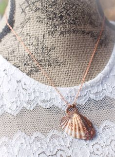 A personal favorite from my Etsy shop https://www.etsy.com/listing/255291126/copper-shell-necklace-nautical-shell