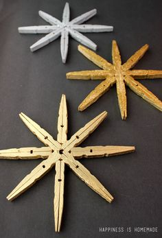 Clothespin Snowflake Tutorial - These clothespin snowflakes take just minutes to make, but add lots of style and pizzazz with their chic metallic gold and silver sparkle!