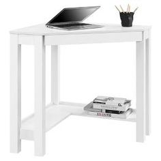 The Room & Joy George Corner Desk allows you to optimize your workspace and that empty corner in your office or den with its convenient triangle shape. This Corner Desk has the classic parsons styling that includes a simple silhouette with clean lines. The Desk features a center storage drawer that's perfect for pens, paper, computer peripherals and other small office supplies. You can find more storage under the Parsons Corner Desk as it has a lower shelf that can hold your binders, ...
