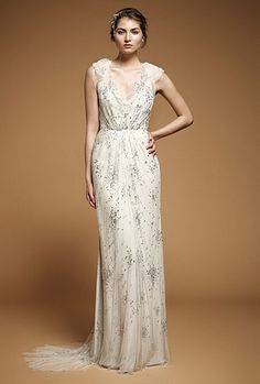 You will feel like you've stepped out of a Jane Austen novel in this gorgeous floral bridal gown that's perfect for an outside garden wedding and could even be used for a tea reception. We say forgo the veil and go for a wide brimmed hat or let you hair flow down to your shoulders. The sparkles also add just the right amount of glitz to catch the natural lighting.