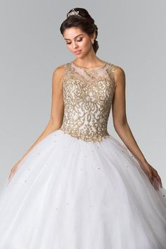 Sheer illusion sweetheart neckline gold embroidered beaded bodice Ballgown Quinceanera sweet 16 prom dress. Featuring gold lace appliques throughout bodice, key hole corset back and tulle skirt.