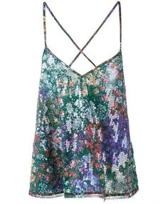 This multi-coloured Marques Almeida printed floral top is from the designer's Spring/Summer 2016 Resort collection. Feminine and elegant, the loose-fitting piece is uplifted by the sexy criss-cross back and subtle sequin detailing that gives it a unique shine. Style it with the matching flowy skirt to embrace a boho-chic appearance.
