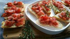 Organic Bruschetta from Aris   Ingredients: - 5 organic plum tomatoes  - 1 clove garlic, minced  - fresh basil, thyme, parsley - olive oil, salt & pepper - baguette bread    Preparation: Chop the tomatoes into small pieces, add minced garlic, olive oil, herbs, salt & pepper. Toast the baguette slices, brushed with olive oil and garlic, in the oven.  Serve the toasted bread with the tomato mixture.  Simply delicious! #organic #organicbrothers #natureandmore #eosta #recipe #bruschetta