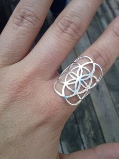 ****All handmade in Montreal, Canada in my studio****  This sterling silver ring measure about 1 inch or 28 mm from top to bottom and is very comfortable to wear!  Available in all sizes, Just let me know your finger size ;) Also available in bronze, gold 10k, gold 14k and rose gold ! See my shop at https://www.etsy.com/ca/shop/KIANZO?ref=hdr_shop_menu   ****The seed of life is a symbol of sacred geometry. Representing ancient spiritual beliefs,it depicts fundamental aspects of time and…