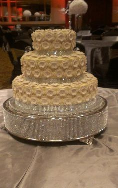 Bling and Blossoms Wedding Cake - Bride sent me a pic of cake she wanted,  it's a 14, 10, and a 6 in, 14 is Strawberry with White Chocolate filling,  the 10 is  French Vanilla with Rasberry Filling and 6 in is Chocolated with oreo cookie and cream.