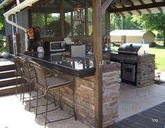 deck, screened porch, stairs, outdoor kitchen and bar area...