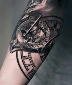 Sun dial tattoo