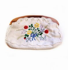 I had one of these!  You could change the outside cover.  I loved it - Vintage Embroidery Purse, White Floral, Wood Handle
