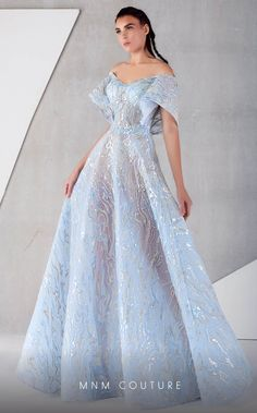 groom dress Please refer to Size Chart # sophisticated and classy with this dress by MNM Couture This embroidered gown fashions an off the shoulder neckline with wide sleeves. Ball Gowns Evening, Ball Gowns Prom, Ball Gown Dresses, Blue Ball Gowns, Elegant Ball Gowns, Blue Gown, Royal Ball Gowns, Elegant Evening Dresses, Modest Evening Gowns