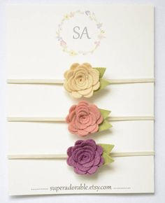 Baby Headbands. Each flower measures around 1 inch and is securely attached to a skinny baby headband. Perfect for your little girl! Great for photos or everyday wear! You will get 3 felt flower headbands! You can pick your colors OR get the colors shown on 1st picture (BeachSand,