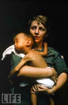 Vietnam War Medical - Nurse caring for a sick Vietnamese child at a MUST field hospital