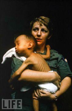 Vietnam War Medical - Nurse caring for a sick Vietnamese child at a MUST field hospital