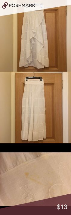 High Low White Ruffle Skirt ** Love the item but not the price? MAKE AN OFFER! 😊 ** High Low White Ruffle Skirt. Size Small. Subtle Flower detail on alternating panels. Fold-over Waist. A small stain on the back towards the bottom. Otherwise, good condition. Final sale. Skirts High Low