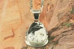 Native American Jewelry White Buffalo Turquoise set in Sterling Silver Pendant. Created by Navajo Artist Arkie Nelson.