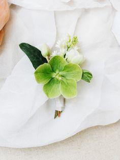 Organic + green spring boutonniere: http://www.stylemepretty.com/2016/05/12/sand-dunes-wedding-inspiration/   Photography: Tenth & Grace - http://www.tenthandgrace.com/