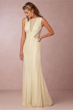 From the geometric detailing and edgy cut outs, BHLDN's Hannah gown is the perfect match for any boho bride.