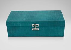 Long Turquoise Croc Box - EA Its fashionable good looks are reason enough to want this glossy, crocodile-embossed leather box. Snap open the polished nickel hardware – as stylish as the clasp on any designer clutch— flip back the top, and it's as useful as it is gorgeous. It's fitted with a removable divided tray plus a spacious open compartment below, all lined in plush velvet to cradle your jewelry, watch collection, or other treasures softly and safely. Also available in black (439523).