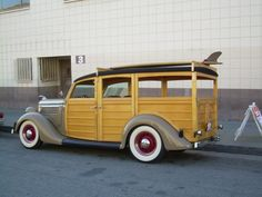 Oh my, its like sex on wheels... damn thats a nice woody surf wagon