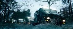 The armored trucks with peacekeepers in district 11
