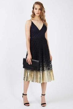 Turn heads in this eye-catching dress in navy blue with a contrast foil hem in pleat metallic. We love the plunge neckline and midi length. Style with ankle strap shoes and an oversized clutch for party-wear perfection. #Topshop