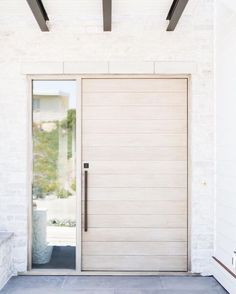 There is an exterior trend we've been loving--light wood entry doors.Today we have a beautiful roundup of light wood doors for every aesthetic to help inspire your own design. Timber Front Door, Modern Front Door, Front Door Design, Modern Wood Doors, Unique Front Doors, Modern Exterior Doors, Modern Entryway, Exterior Cladding, The Doors