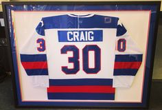 Jim Craig Team USA hockey jersey custom framed for a local athlete! Come see why we're the obvious choice for jersey framing in Denver! #denver #colorado #jerseyframing #sportsframing #teamusa #jimcraig #miracleonice