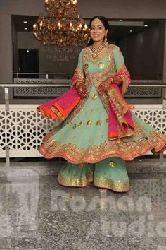 214f56cc64b This mother of bride outfit looks as beautiful as it is comfortable. Teal  long kurta