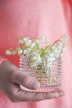 Lilies of the valley in a Kastehelmi candle holder from Ittala. http://www.blog.florainspiro.com