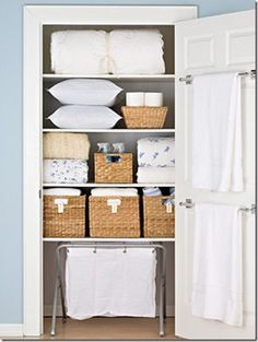linen closet...hmm wonder if I can have mine look this organized ...but I do like the idea of baskets on my wire shelves