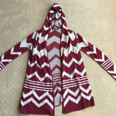 Hooded cardigan Red and white hooded cardigan!! Super cute and comfortable cardigan, size medium. The stitching on the arms are unique and different! Sweaters Cardigans