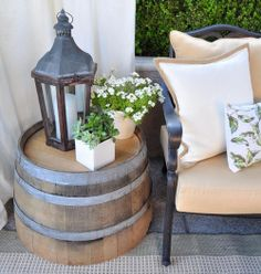 Home Decoration - Front porch decor: half-whiskey barrel table, Lantern, flowers pulled, curtain =. Table Baril, Outdoor Spaces, Outdoor Living, Outdoor Tables, Outdoor Seating, Rustic End Tables, Outdoor Parties, Outdoor Kitchens, Farmhouse Outdoor Side Tables