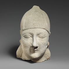 Limestone head of a beardless male wearing a conical helmet Date: 6th century B.C. Culture: Cypriot Medium: Limestone
